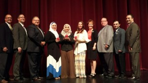 Members of the business and educational communities congratulate the 2015 Teacher of the Year honorees. From left to right: Dearborn Area Chamber past chair Gary Kearns of Kearns Brothers, Jim Kroll of Lafontaine Automotive Group, Dearborn Area Chamber Education Committee Chair Philipp Emma, Teacher of the Year winners Samia Fawaz (3rd-5th grades), Sharifah Ahmed (middle school), Amanda Lichocki (high school), Dearborn Area Chamber President Jackie Lovejoy, Dearborn Public Schools Superintendent Brian Whiston, Dearborn Area Chamber Events & Media Relations Director Ron Hinrichs, and Dearborn Education Foundation Executive Director Eddie Fakhoury. Honoree Seena Ankouni (PK-2nd grades) is not pictured.